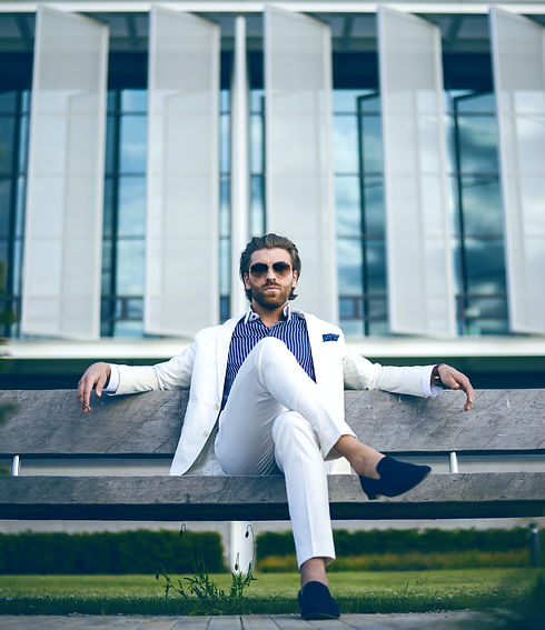man-wearing-white-suit-jacket-and-white-