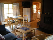 Kasvik cottages inside, with sofa, fireplace, lcd tv, dinner table etc