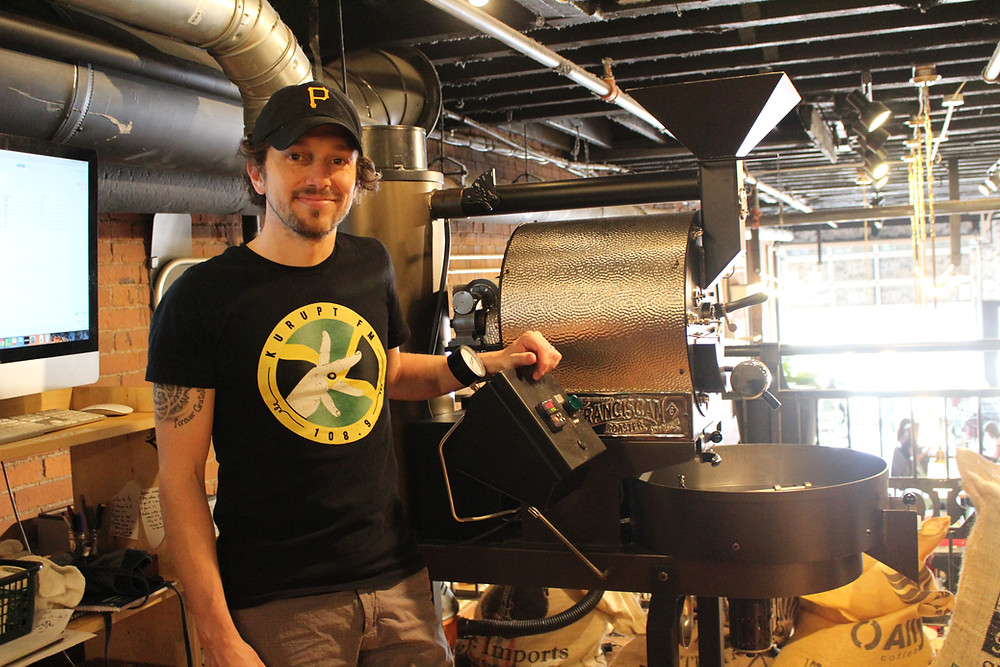 Matt Marietti, founder and co-owner of De Fer Coffee in front of one of his coffe roasters
