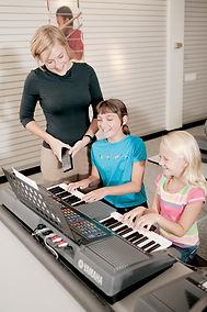 Girl_laughing_with_teacher.jpg