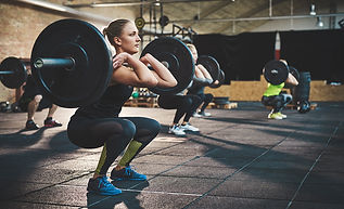 1200-woman-lifting-heavy-weights.jpg