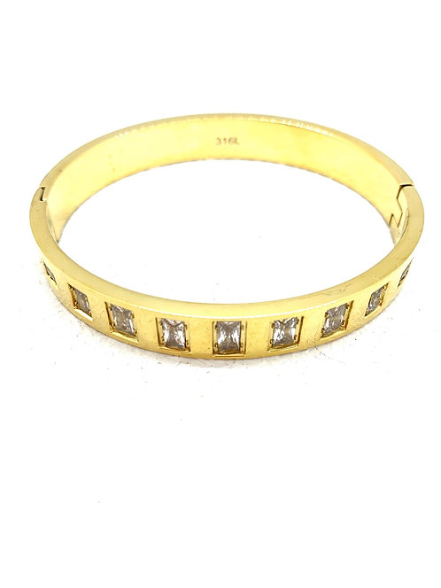 Gold plated stainless bangle with emerald cut CZ's