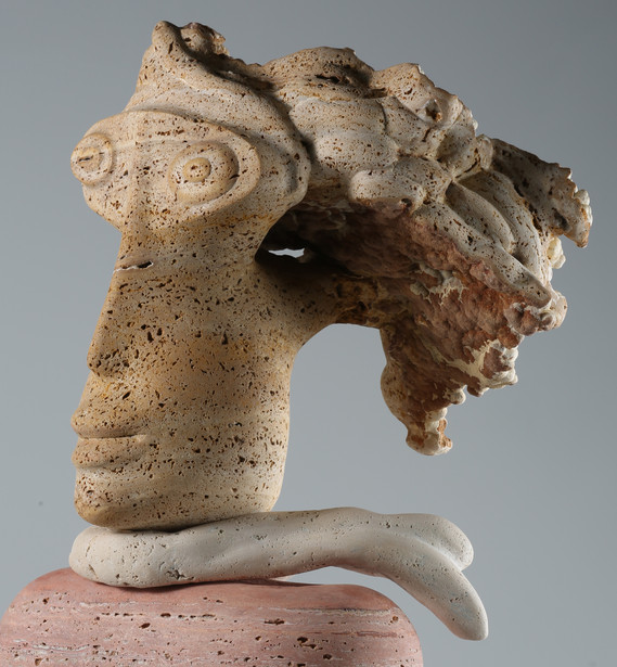 TRAVERTINE MARBLE HEAD OF A WOMAN