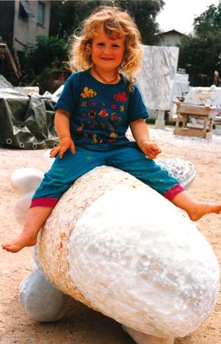 Allegra on a sculpture