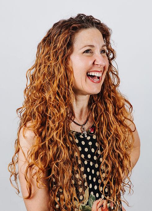 headshot polka dot dress smiling.jpg