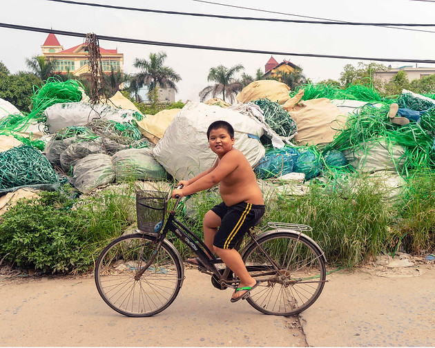 Potatoes to Plastic explores the informal plastic recycling village Minh Khai, Vietnam. Formally farming sweet potatoes, the residents of Minh Khai have found a new economy in plastic recycling, primarily sourced from nearby cities or shipped from other Asian and European countries. The project brings to light the paradoxical situation of plastic recycling in informal spaces, and highlights the quantities of plastic being dealt with in one of the worlds biggest plastic polluting countries.