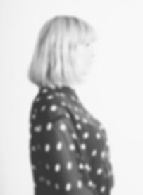 studio portrait from Linnea Riensberg. shot in berlin in 2015, she wears a dot blouse.