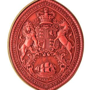Escudo victoriano con león y unicornio