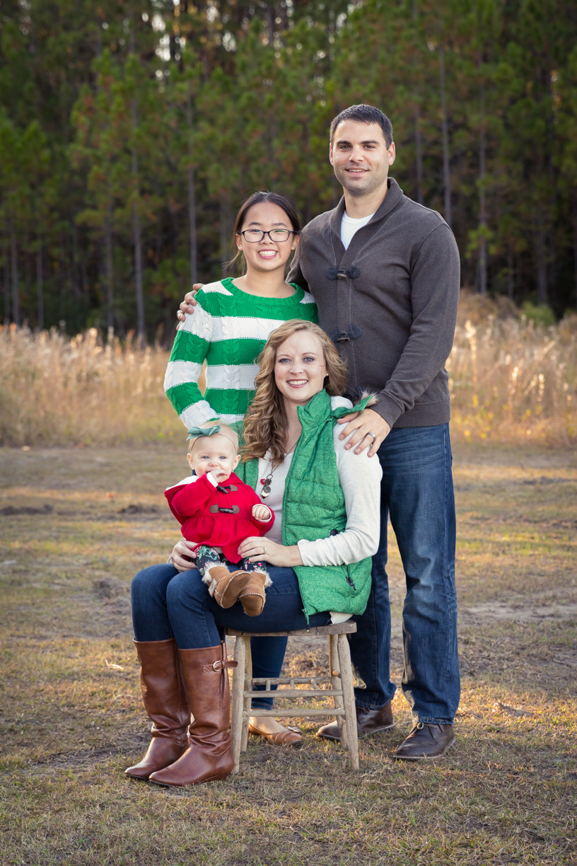 Baby Mother Father and Teen smiling posed by Smith Creek Park Open Field