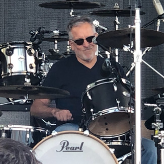 ...and on drums, mister Dan E Clausen!