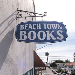 Beach Town Booksign looking toward the great Pacific Ocean