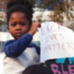 child holding blm.jpg