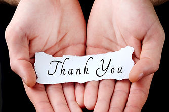 Man holding thank you word in palm.jpg