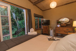 Master bedroom with private deck in rainforest