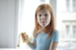 positive-cute-little-girl-eating-banana-