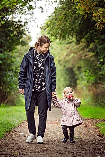 woman-walking-with-child-on-pathway-2505