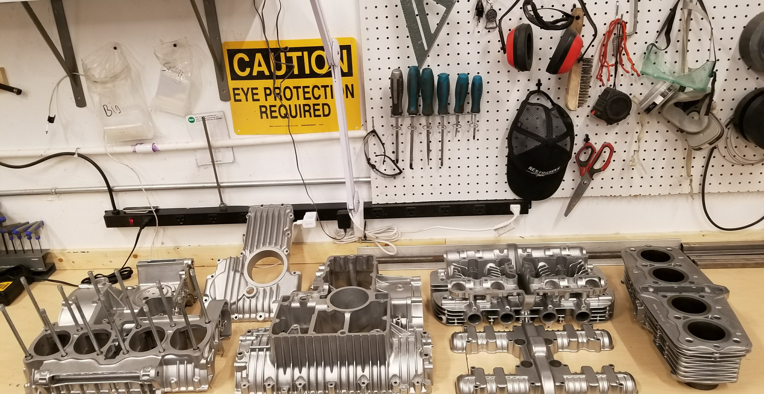 Ahh, that's better. Everything is spotless and vapor blasted and now we're off to the machine shop for a completely rebuilt head, new pistons and rings and bore, then reassembly.
