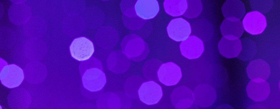 neon-purple-lights-a-woman-holding-a-mob