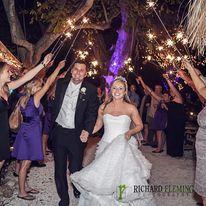 BRIDE AND GROOM SPARKLERS OUTSIDE.jpg
