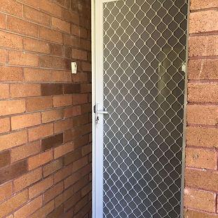 White aluminium hinged grille door.jpg