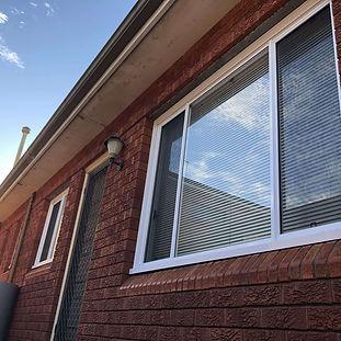 White aluminium sliding window.jpg