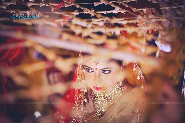 Beautiful Bride Walking Under the _Phoolon KiChadar_ (Flower Sheet) _One of my Favourite Wedding Sho