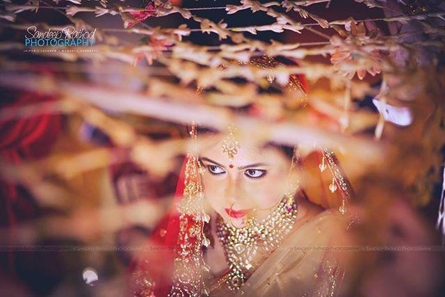 Beautiful Bride Walking Under the _Phoolon KiChadar_ (Flower Sheet) _One of my Favourite Wedding Sho