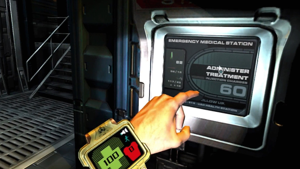 A screenshot from the VR Game DOOM 3: VR Edition. The player reaches out with their hand to interact with a touch-screen medical station. On their wrist, a large watch-like device shows the player's health, armour, and flashlight battery.