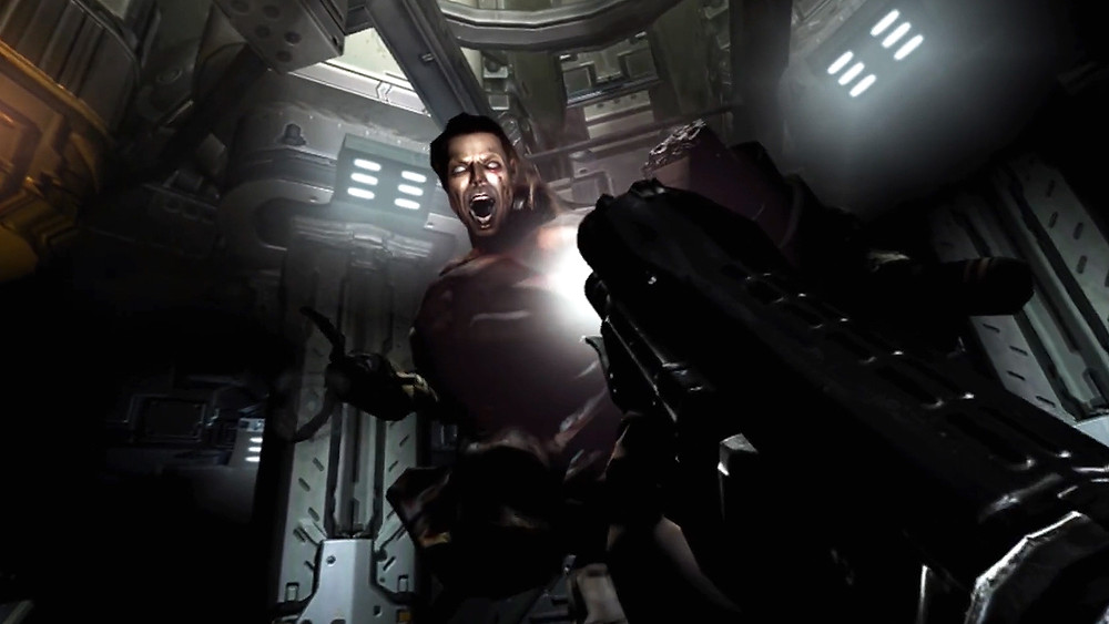 A screenshot from the VR game, DOOM 3: VR Edition. The boss enemy Sabaoth rises up to strike the player, who takes aim with a futuristic weapon.