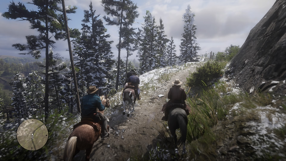 A screenshot from the video game, Red Dead Redemption 2. Four cowboys ride on horseback down a snowy mountain ridge. In the lower left corner, a user interface element appears, displaying the characters' location in the world map.