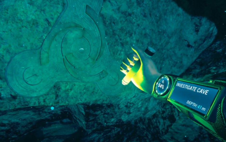 """A screenshot from the virtual reality video game, FREEDIVER: Triton Down. The player character is holding a glowstick, and extends their arm to illuminate a wall carving. Various interface elements appear on the arm, including an oxygen meter and a mission display screen that reads """"INVESTIGATE CAVE, Depth: 41 M"""""""""""