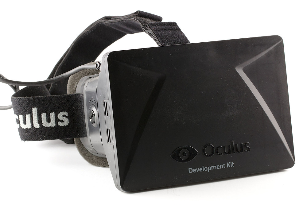 Oculus Dev Kit 1, a boxy black piece of virtual reality hardware with the Oculus logo on the front.