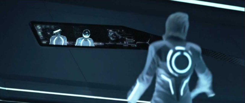 A still from the film TRON: Legacy. In a futuristic club lit by TRON-like white lights, the members of the band Daft Punk play music from a disc jockey booth in the wall.