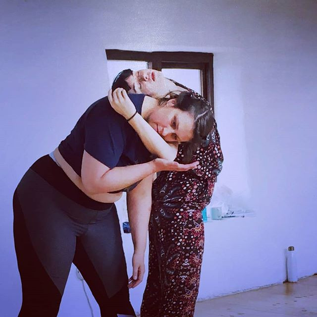 I am dancing with my friend Deanna Drennen at the Embodied Artists' Retreat.  I am cradling her elbow in my hand and she has laid her head on my shoulder.