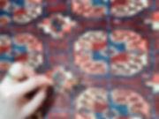 Restauration en cours tapis asie centale tribu tekké point d'arrêt trou à réparer motif recréé