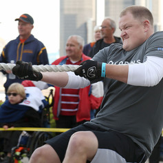 WINDSOR, Ont. (20/09/15) - Chris Deware of the Fiat Chrysler Automobiles Renegades pulls on a rope attached to a transport truck while competing in the third-annual Ram Tough Truck Pull for the United Way on Riverside Drive in Windsor on Sunday, Sept. 20, 2015. Teams had to pull an 80,000 lbs. transport truck filled with Dodge Ram pickup trucks a distance of 50 feet as fast as possible as part of the event. Deware's team had raised more than $10,000, which was the highest amount raised for ...