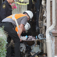 WINDSOR, Ont. (21/10/15) – Members of the Office of the Fire Marshal inspect the damage of a house effected by a natural gas explosion in the 1400 block of Francois Road in Windsor on Wednesday, Oct. 21, 2015. The explosion originated from the basement of one of the houses according to Windsor Fire and Rescue Services. The two other houses were damaged by flames and heat. Photo by Justin Prince, The Converged Citizen