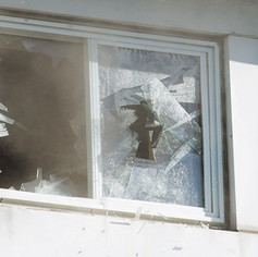 WINDSOR, Ont. (30/11/15) - A member of the Windsor Fire and Rescue Services smashes a window to let smoke out after a house fire at 520 Church Street in Windsor on Monday, Nov. 30, 2015. Photo by Justin Prince, The Converged Citizen