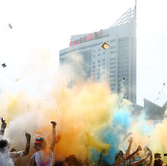 WINDSOR, Ont. (18/07/15) – Participants for the 2015 Color Run throw pouches of coloured powder into the air during the finish party in Riverfront Festival Plaza in Windsor on Saturday, July 18, 2015. Photo by Justin Prince, The Converged Citizen