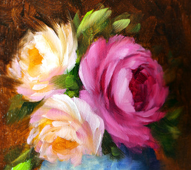 A vase of garden roses