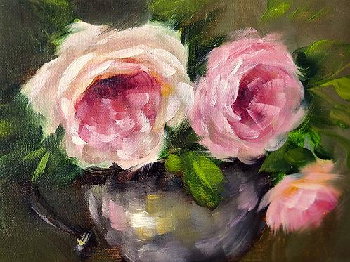 A silver creamer of garden roses