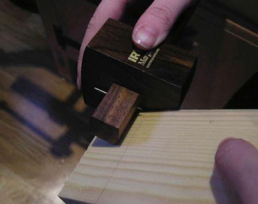 Using a marking gauge to scribe the length of the tenon