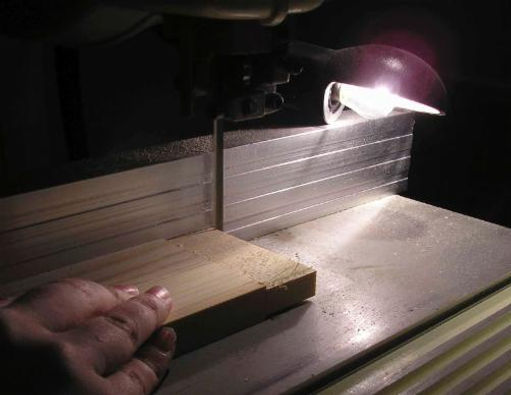A smaller bandsaw is used to cut the tennon to length.