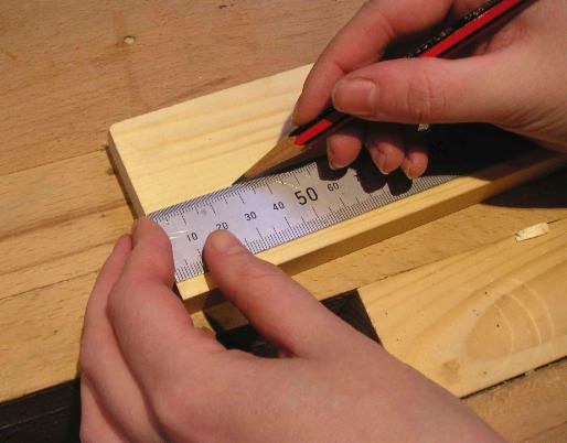 Using a steel rule and sharp pencil to mark a point for the shoulder of a tenon. 0.1mm accuracy.