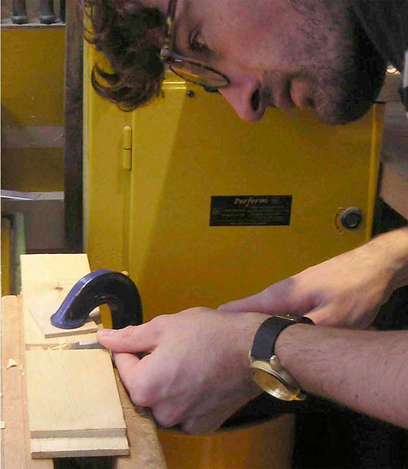 London Woodwork Class student demonstrating traditional chiselling of a housing joint.