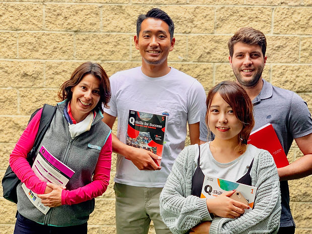 Students holding textbooks.jpg