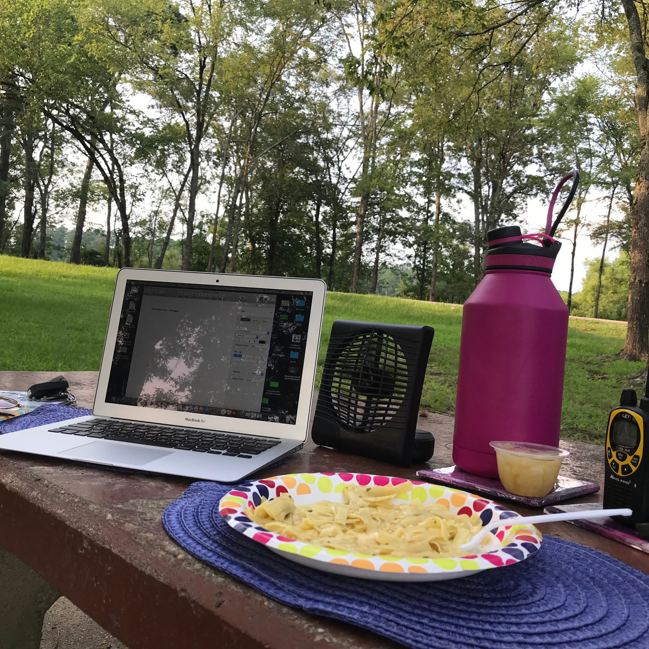 My typical night set up at my camp with my work and my radio.