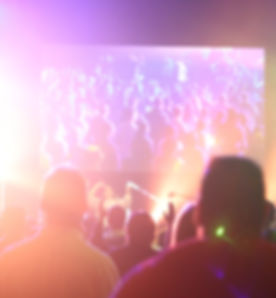 group of people having a party inside dark room with light effects_edited.jpg