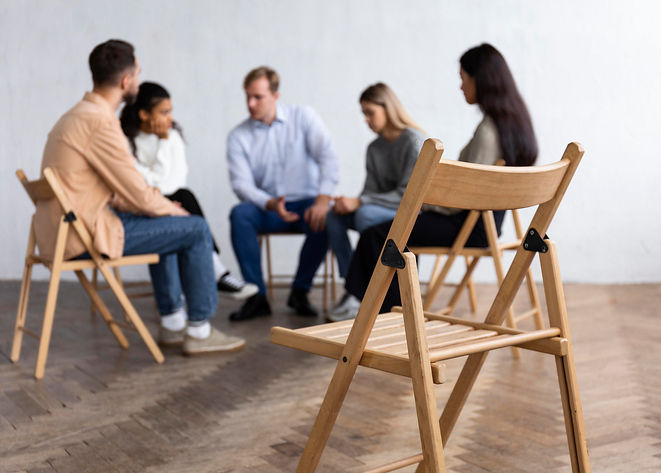 people-conversing-at-group-therapy-sessi