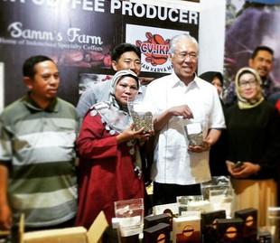 Genesis Coffee, as a representative of W